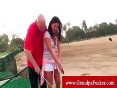 lucky old man plays golf with hawt legal age
